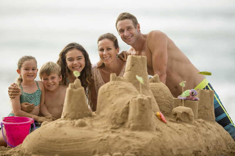 Family Building a Sandcastle Together