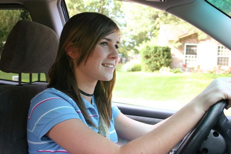 Teenage Girl Driving in Car