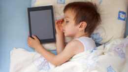 Boy, sleeping with tablet