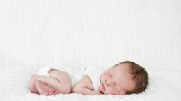Newborn Baby Sleeping Wearing White